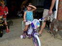 Katey's 1st bike. It was a Disney Princess bike. Too big for her so we have to exchange it, but it still counts as a first.