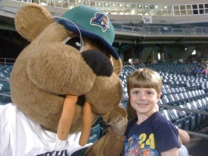 Caleb with Boudreaux, the Zephyrs mascot.