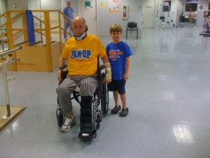 Pop pushing his wheelchair on his own. Caleb following close behind.