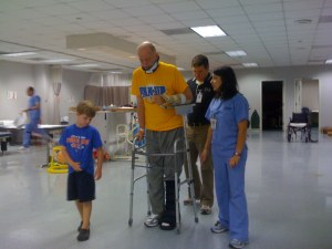 Caleb walking with Pop and Jennifer and a PT student.