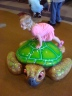 Abby climbing the turtle.