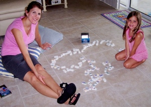 (Mommy and Katey enjoying some dominoes one of the afternoons it rained)