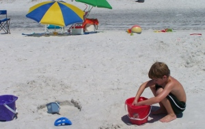 (Caleb laying the foundation for his sand castle)